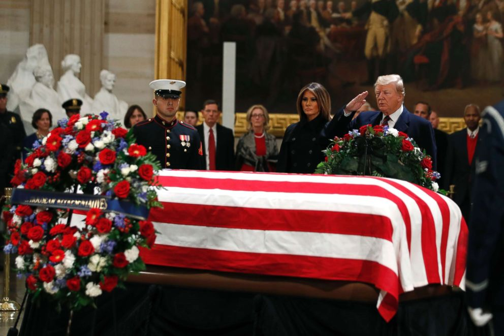 PHOTO: President Donald Trump and first lady Melania Trump pay their respects to former President George H. W. Bush, as he lies in state in the Rotunda of the U.S. Capitol, Dec. 3, 2018.