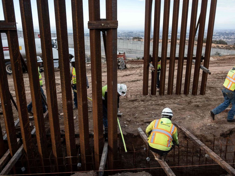 PHOTO: A construction crew works on replacing the U.S.-Mexico border fence near Tijuana, Mexico, Jan. 9, 2019.