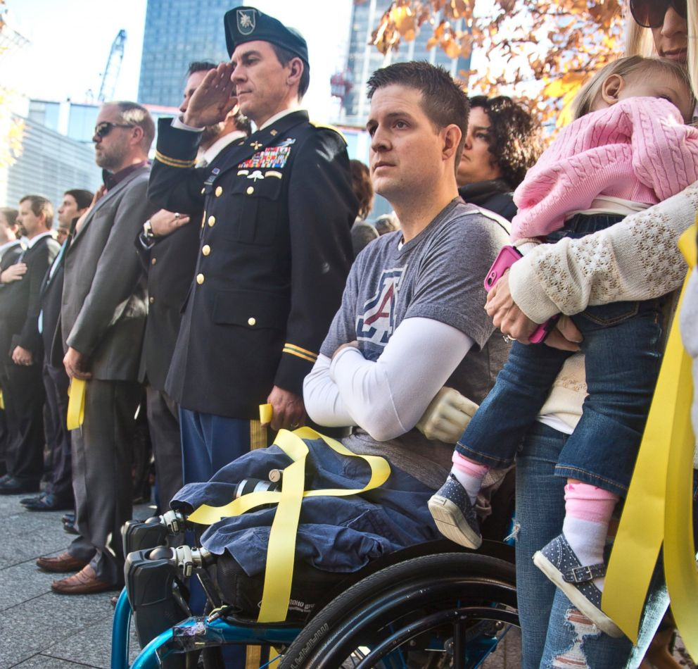PHOTO: In this Nov. 10, 2014, file photo, former U.S. Air Force Senior Airman Brian Kolfage, center, sits in a wheelchair next to his wife Ashley, right, during the National September 11 Memorial and Museums Salute to Service tribute.