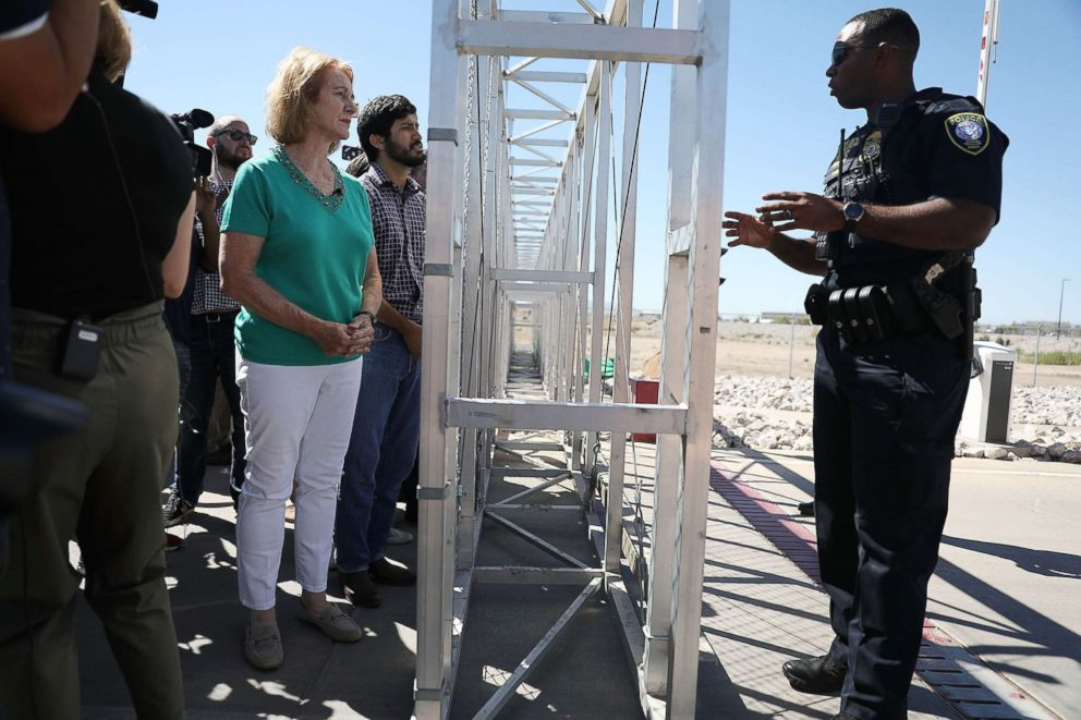 PHOTO: Police officer as she is told she cannot cross through the gate to the tent facility setup at the Tornillo-Guadalupe Port of Entry as she joins with other mayors, June 21, 2018 in Fabens, Texas.